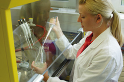 Student performing tests in a lab